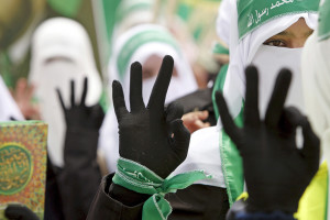 APRIL 20: Palestinian students supporting Hamas flash three fingers to draw attention to their electoral number during an election campaign for student council at Palestine Polytechnic University in the West Bank city of Hebron. Reuters