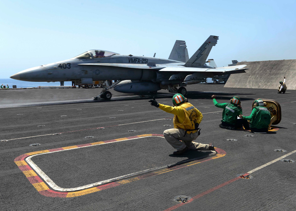 An F/A-18C Hornet launches from the flight deck of the aircraft carrier USS Theodore Roosevelt during operations in the Arabian Sea.