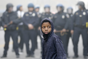 Police move a protester back, Monday. The Associated Press