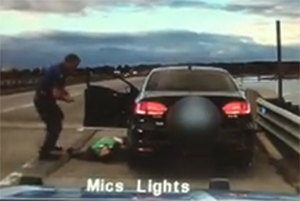 A cruiser camera video shows Maine State Police Trooper Douglas Cropper trying to revive a man early Friday morning on Interstate 295, then dragging him from the car onto the road, where he starts to massage the man's chest.