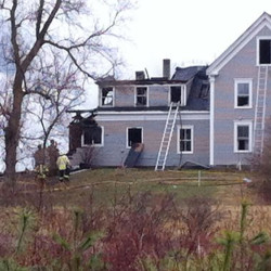 Crews at the scene of a house and barn fire at 91 Union Falls Road in Dayton. Photo courtesy WCSH-TV