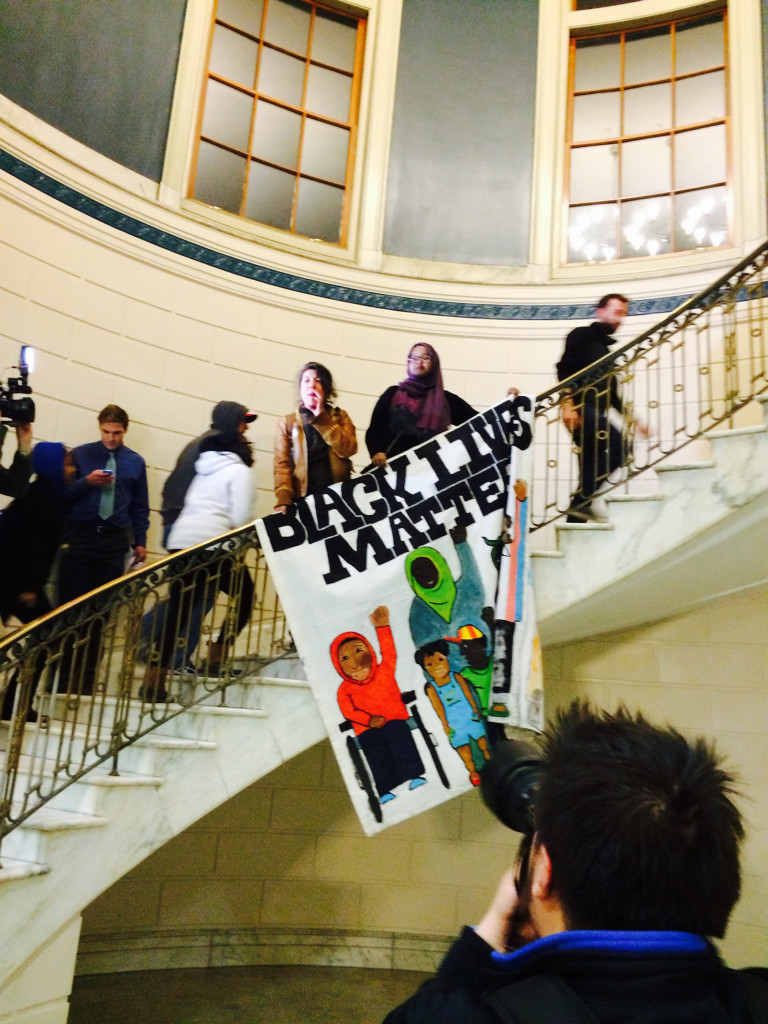 Protesters decrying racism move upstairs at Portland City Hall to address Mayor Michael Brennan on Thursday night in the City Council chambers.