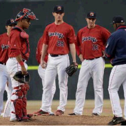 Portland pitcher Mike McCarthy, center, waits for Manager Billy McMillon to remove him from the game in the fifth inning of the Sea Dogs' 14-4 loss Monday in Portland.  Shawn Patrick Ouellette/Staff Photographer