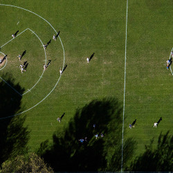 An aerial view of a lacrosse game on a field at Hebron Academy.
