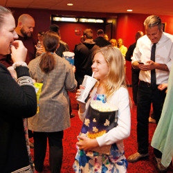 """Zombie star Sydney Shiben, 10, snacks on popcorn with her cousin Julia Plummer, both of Falmouth, as they wait to see Thursday night's premiere of the Portland-made film """"Night of the Living Deb"""" at the Nickelodeon Cinemas."""