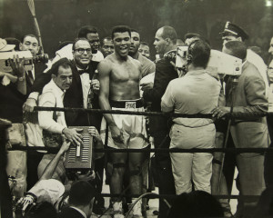 "Muhammad Al tells the crowd and television audience how he won the fight against former Heavyweight Champion Sonny Liston. Ali knocked Liston out with the ""phantom punch"" midway through the first round. Photo from the archive of the Evening Press"