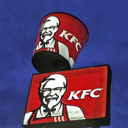 KFC signs featuring the iconic image of Colonel Sanders in Shelbyville, Ky. KFC is reviving the long-dead visage of ìthe brand's greatest asset with a handful of increasingly odd Web, broadcast, social media and in-store experiences. Bloomberg News photo by Luke Sharrett).
