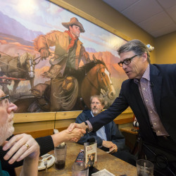 Former Texas Gov. Rick Perry greets voters during a meet and greet event at Pizza Ranch in Sioux Center, Iowa. Perry is making a hands-on pitch in Iowa after mostly avoiding retail politics there in the 2012 primary.