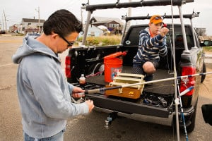 Barrett Johnson and his son Wyatt, 11 of Lyman, make sure their fishing rods and reels are in good working order before heading to the water.
