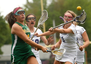 Molly Watterson of Deering, right, tries to block a shot by Greta DiPierro of McAuley.
