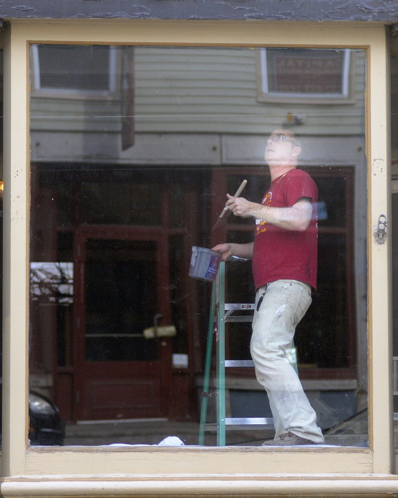 Chris Vallee paints trim inside the windows of a building he's renovating on Water Street in Hallowell in this April file photo. The Quarry Tap Room should be open by May, Vallee said, and offer a selection of up to 30 beers. Vallee and his business partner, Steven Lachance, plan to operate the bar as a hobby, Vallee said. Andy Molloy/Kennebec Journal