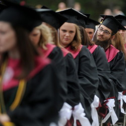 "University of Maine at Farmington's class of 2015 files in for commencement ceremonies in May. The university has a 56 percent graduation rate, according to the federal government's new ""college scorecard."""