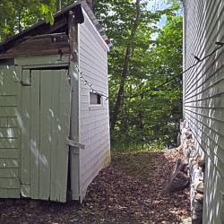 The outhouse stands behind the Vienna Union Hall.