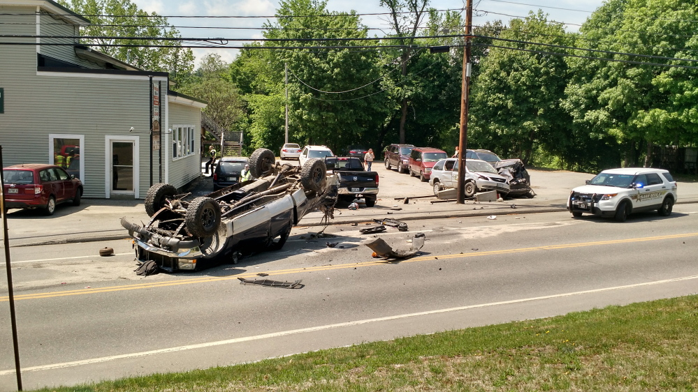 A pickup truck rests on its roof on Main Street in Farmington after leading a Franklin County Sheriff's deputy on a chase, and crashing into three parked vehicles. The teenaged driver was taken to the hospital and faces charges.
