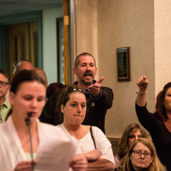 Greg Blouin, center, and Mellisa Luedke, right, object to Biddeford city councilors after Mayor Alan Casavant banged his gavel for Samantha Rocray-Parenteauat to stop speaking, to close the public comment portion Tuesday night's meeting.