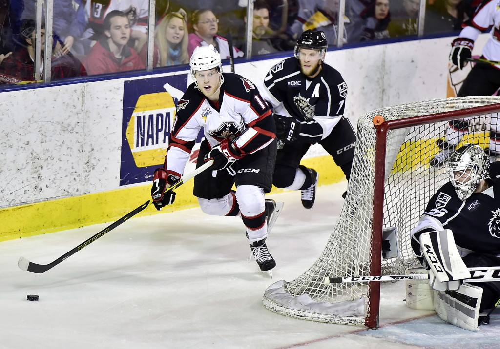 Francis Wathier, chased by Andrew Bodnarchuk of Manchester, has received more ice time for the Portland Pirates in the playoffs and taken advantage, including two goals Thursday night in a 5-0 victory. Gordon Chibroski/Staff Photographer