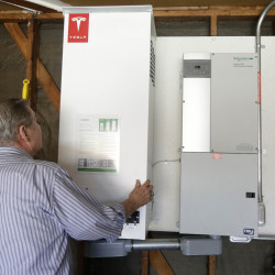 A prototype Tesla battery system powers the Foster City, Calif., home of David Cunningham , who installed the battery late last year to pair with his solar panels as part of a pilot program run by the California Public Utilities Commission.