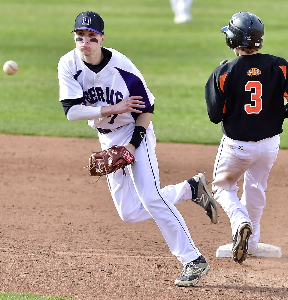 Deering shortstop Nick Bevilacqua fires to first base in an attempt to complete a double play after forcing Sam Collins of Biddeford at second base. Deering scored three runs in the seventh inning to pull out the victory.
