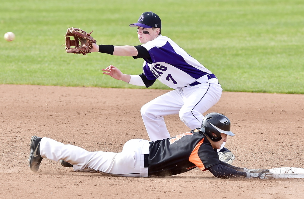 Deering shortstop Nick Bevilacqua waits for a late pickoff throw Thursday as Joe Curit of Biddeford slides safely back to second base during Deering's 6-5 victory at Hadlock Field.
