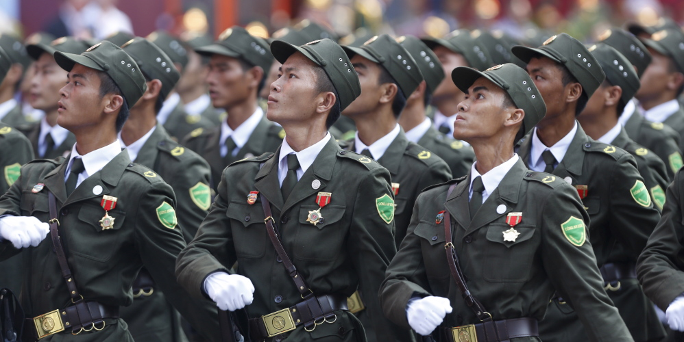 Village policemen march during a military parade to mark the 40th anniversary of the fall of Saigon in Ho Chi Minh City, Vietnam, on Thursday. The capture of Saigon by North Vietnamese forces ended a war that lasted 30 years.