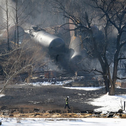 The scene of a train derailment near Mount Carbon, W.Va., in February. Rail tank cars that are used to transport most crude oil and other flammable liquids will have to be built to stronger standards under a series of new rules unveiled Friday by U.S. and Canadian transportation officials. 2015 Associated Press File Photo