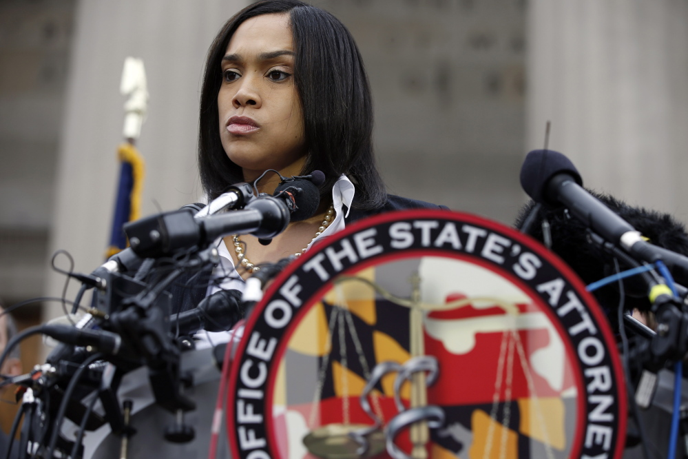 Marilyn Mosby, Baltimore state's attorney, pauses while speaking during a media availability, Friday, May 1, 2015 in Baltimore.  Mosby announced criminal charges against all six officers suspended after Freddie Gray suffered a fatal spinal injury while in police custody.(AP Photo/Alex Brandon)
