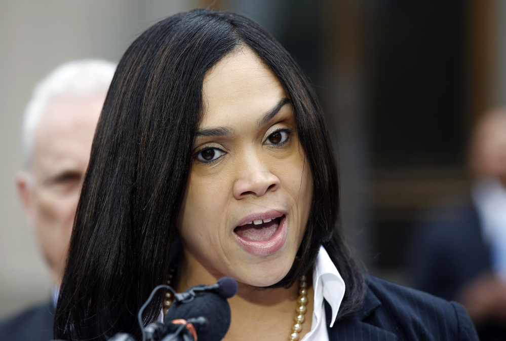 Marilyn Mosby, Baltimore state's attorney, announces criminal charges against all six police officers suspended after Freddie Gray suffered a fatal spinal injury.