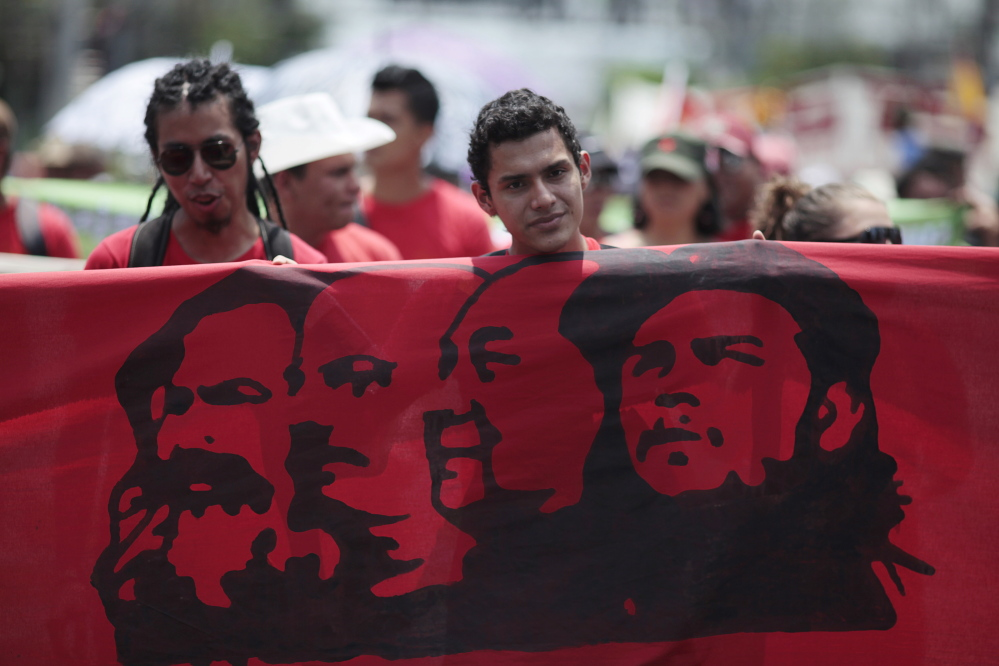 Workers march during the May Day celebration in San Salvador May 1, 2015. International Worker's Day, also known as Labour Day or May Day, commemorates the struggle of workers in industrialised countries in the 19th century for better working conditions. REUTERS/Jose Cabezas  - RTX1B5N8