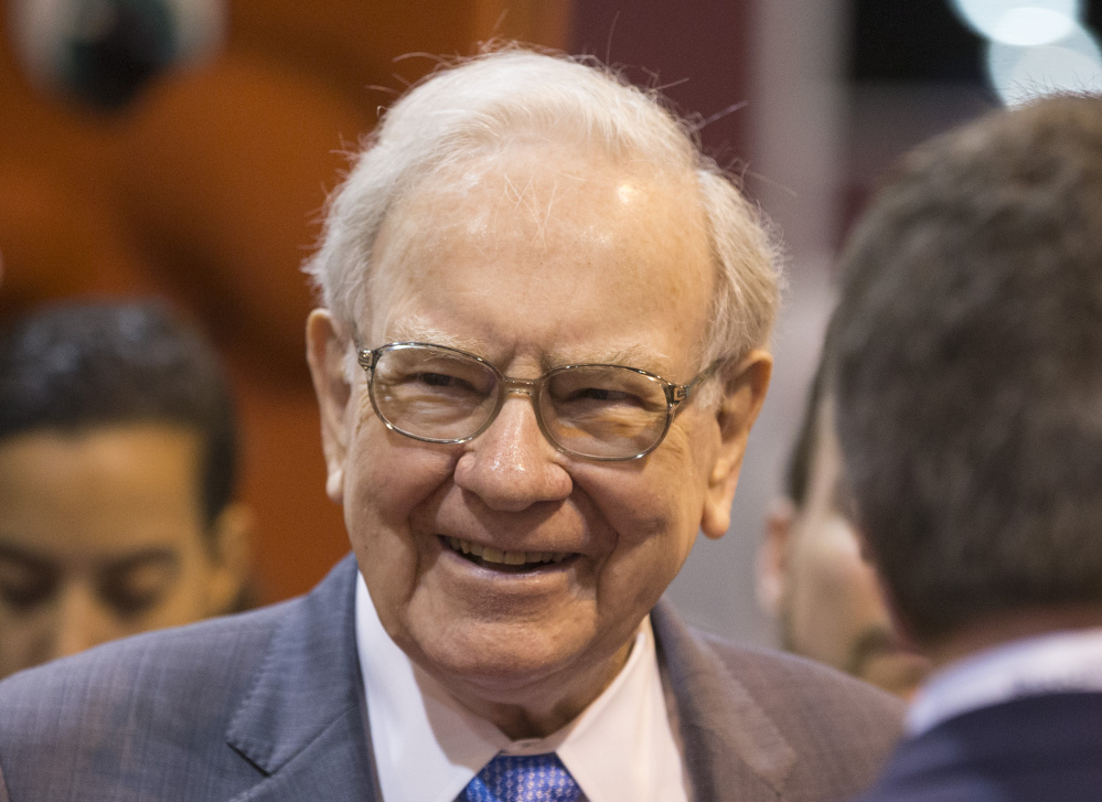 Berkshire Hathaway Chairman and CEO Warren Buffett smiles while touring the exhibit floor before presiding over the annual shareholders meeting in Omaha, Neb., on Saturday.