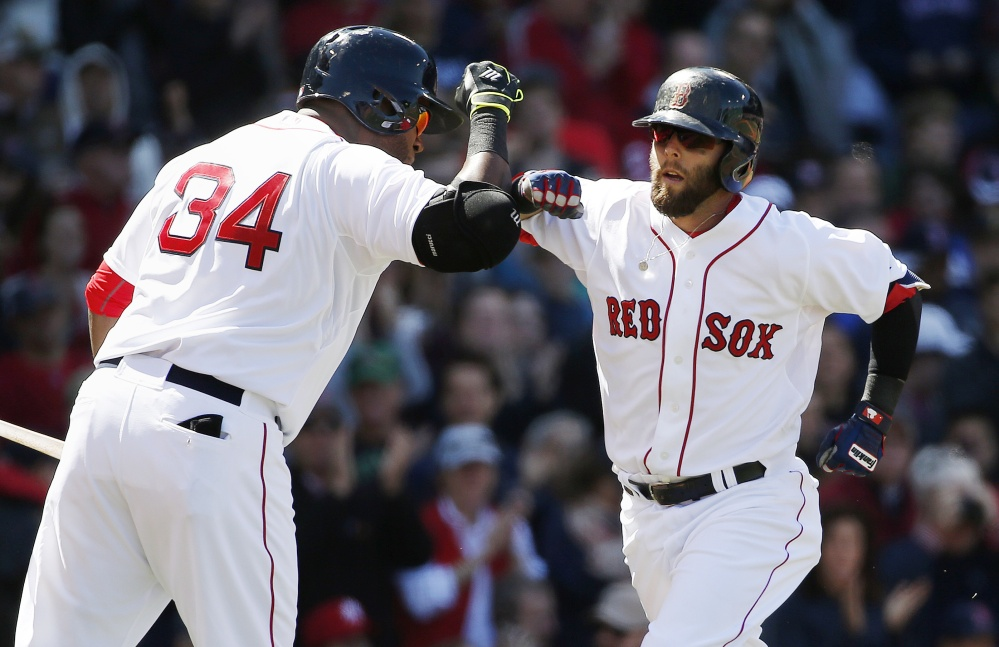 Dustin Pedroia, right, celebrates his solo home run with David Ortiz in the fourth inning against the New York Yankees in Boston on Saturday. The Associated Press