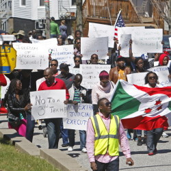 About 250 Burundi immigrants march down Congress Street in Portland on Saturday to call on the United States and other countries to help pressure the Central African nation's president, Pierre Nkurunziza, to abandon his decision to seek a third term.