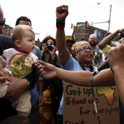 Saturday's rally became jubilant at times with a singer interacting with a baby during a reggae performance on the streets. The Associated Press