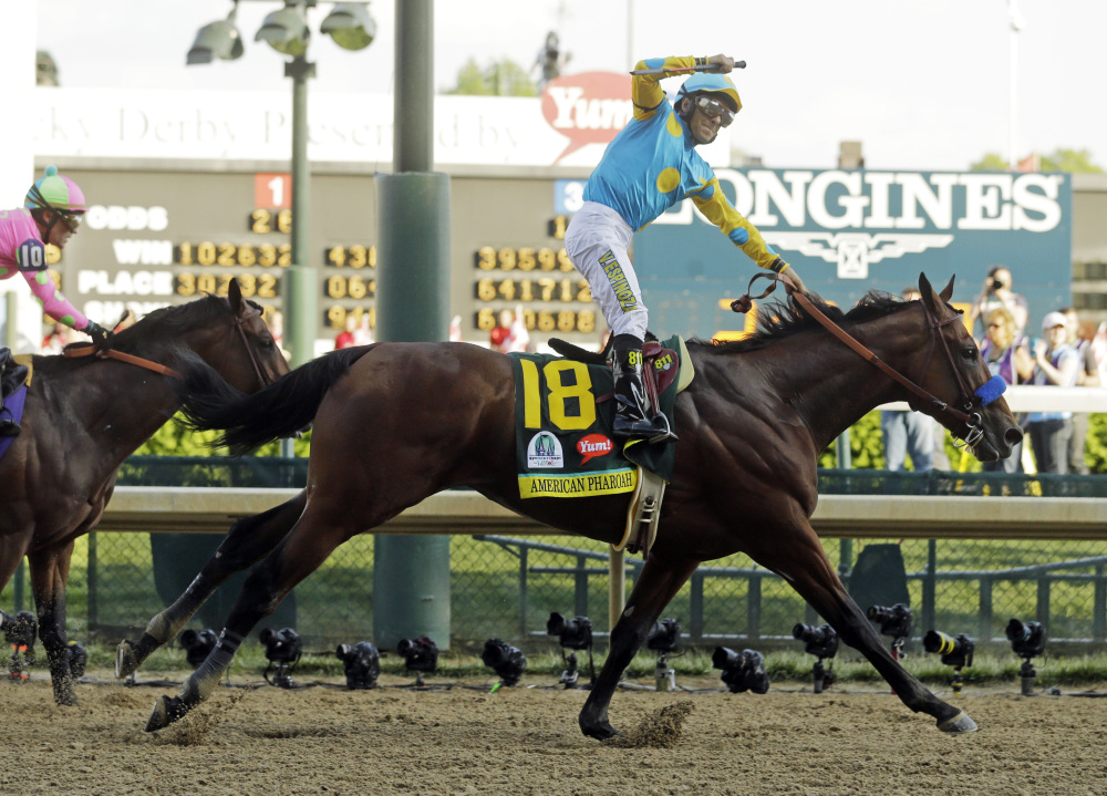 Victor Espinoza rides American Pharoah to victory in the 141st running of the Kentucky Derby horse race at Churchill Downs Saturday in Louisville, Ky.