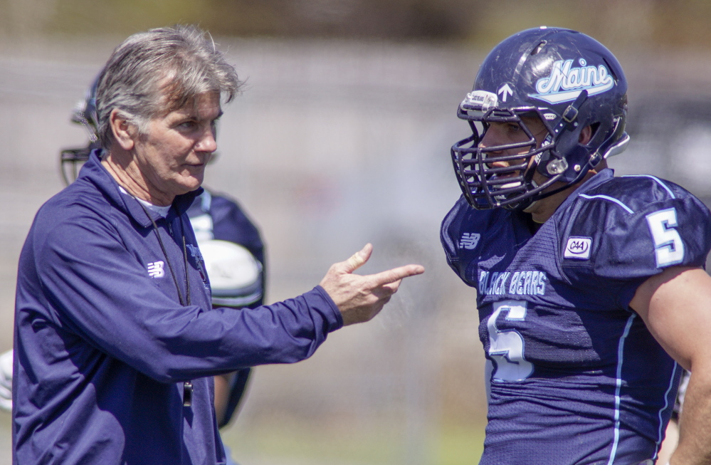 Mike Kozlakowski, right, plans after virtually a two-year wait to be back at defensive end in the fall for the University of Maine, teaming with Trevor Bates to form potentially the best tandem in the league. And if you think that thrills Coach Jack Cosgrove, left, you'd be right.