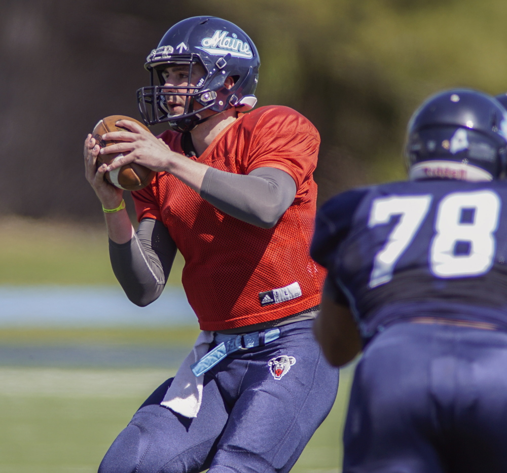 Drew Belcher, who threw two touchdown passes in a scrimmage Saturday, will continue to compete with Dan Collins for the No. 1 quarterback job when the UMaine football camp opens in August.