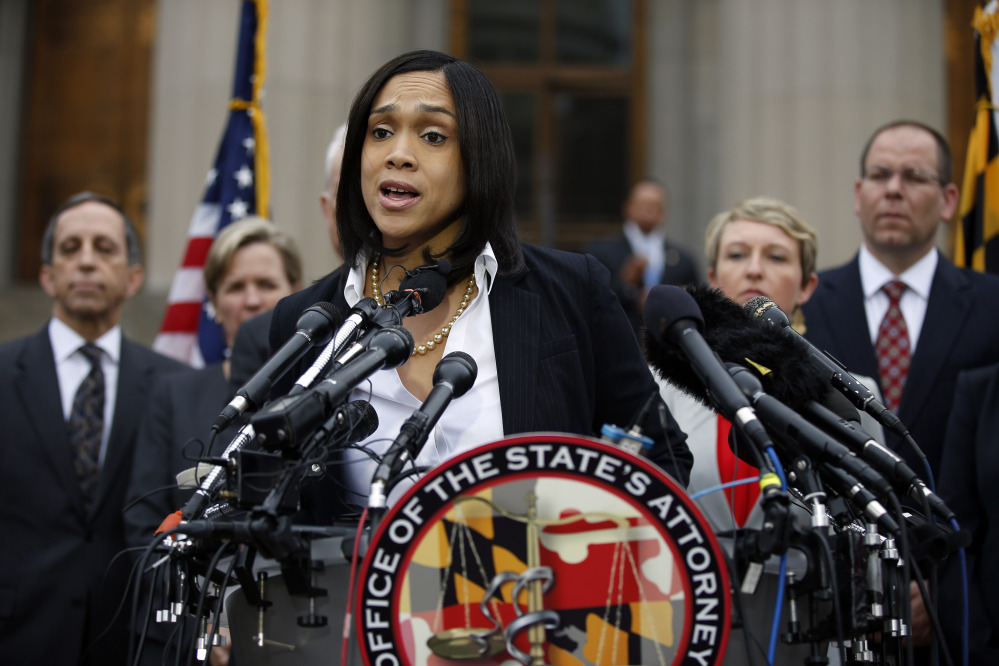 Marilyn Mosby, Baltimore state's attorney, announced criminal charges against all six officers suspended after Freddie Gray suffered a fatal spinal injury while in police custody.  The Associated Press