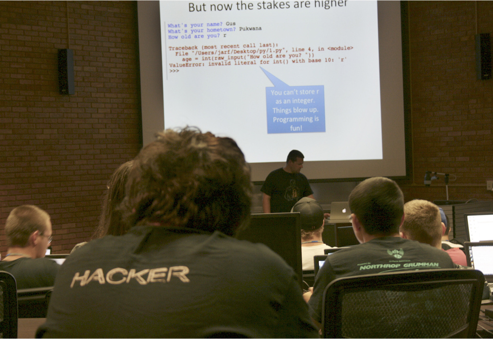 Josh Pauli teaches programming to high school students at the GenCyber Camp last summer on Dakota State University's campus in Madison, S.D., It was one of six camps held nationally in 2014 that were funded by the National Science Foundation and National Security Agency.