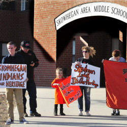 "People who support keeping the ""Indians"" sports mascot for Skowhegan schools gather April 13 at the Skowhegan Middle School to express their opinion."