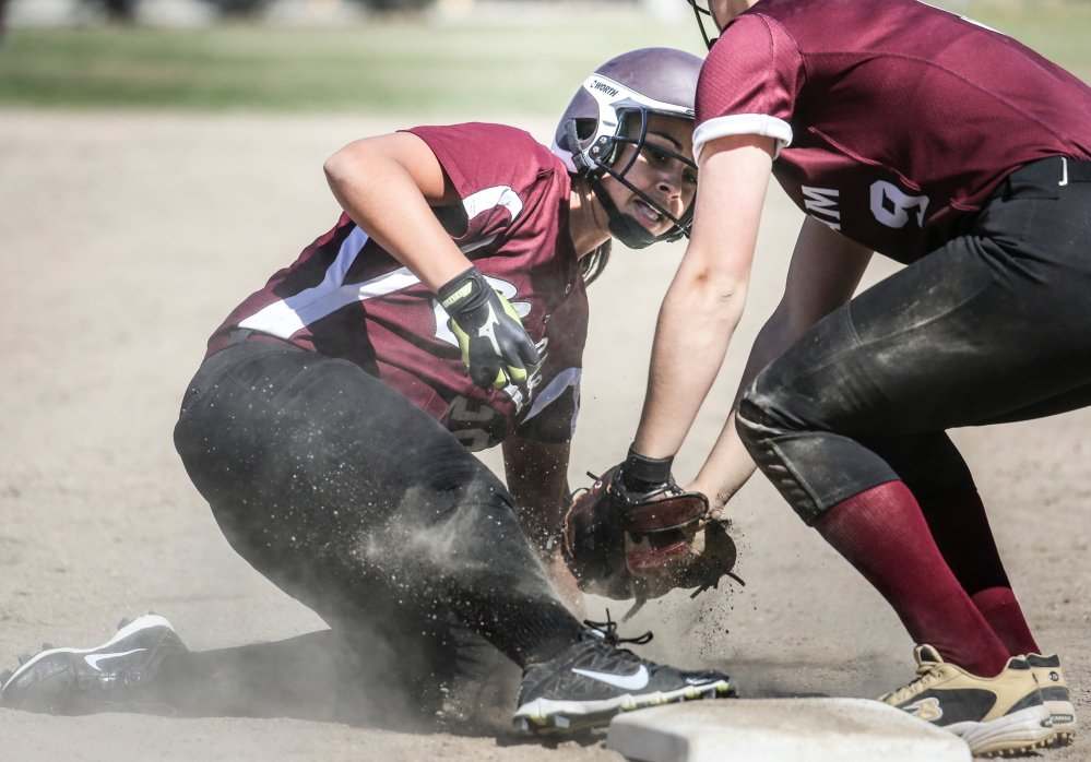 Noble's Tyler Chastney is tagged out by Gorham third baseman Noelle DiBiase. Gorham scored three runs in the sixth inning to secure a 5-2 victory.