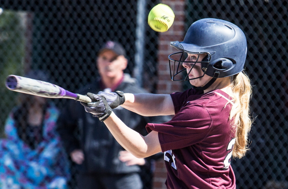 Grace McGouldrick of Gorham fouls off a pitch Saturday in an SMAA softball game against Noble. Gorham evened its record at 2-2 with a 5-2 victory.