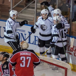Manchester Monarchs players celebrate Michael Mersch's goal less than two minutes into the game Saturday night against the Portland Pirates. Mersch later scored the go-ahead goal in the third period, lifting Manchester to a 5-3 win that eliminated the Pirates from the AHL playoffs.