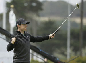 Rory McIlroy reacts after making an eagle putt on the 18th green of TPC Harding Park to win his semifinal match against Jim Furyk at the Match Play Championship golf tournament on Sunday in San Francisco.