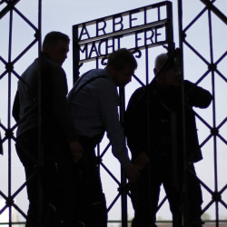 "Blacksmiths prepare a replica of the Dachau concentration camp gate, with the slogan ""Arbeit macht frei"" (""Work sets you free"") at the main entrance to the memorial in Dachau, Germany, on Wednesday. The gate was stolen in November."