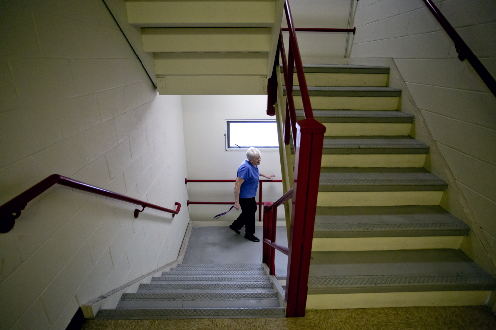 "Jane Croston makes her way down the stairs at 425 Broadway in South Portland. She has friends who are selling their houses but can't find affordable apartments. ""The need is so huge and the resources are so inadequate,"" she said."