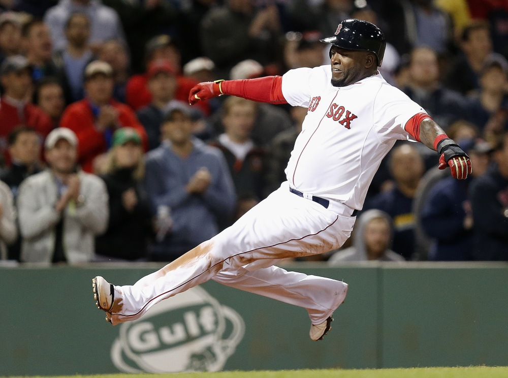 David Ortiz slides safely into home as he scores on a single by Pablo Sandoval in the sixth inning Sunday against the New York Yankees. The Red Sox nearly rallied from an 8-0 deficit, but Ortiz lined out with the bases loaded in the ninth inning to end the game.