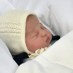 The newborn baby princess, born to parents Kate Duchess of Cambridge and Prince William, is carried in a car seat by her father from The Lindo Wing of St. Mary's Hospital, in London, Saturday.