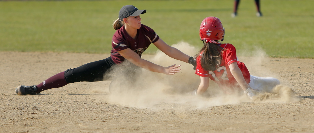 Thornton Academy's Brooke Cross applies a late tag as Scarborough's Hannah Ricker steals second base. Ricker scored the winning run in the sixth inning.