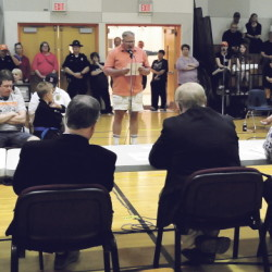 "Phil Goodell Jr., center, speaks to the SAD 54 school board and administrators during a forum on the use of the word ""Indians"" for school sports team in Skowhegan on Monday."