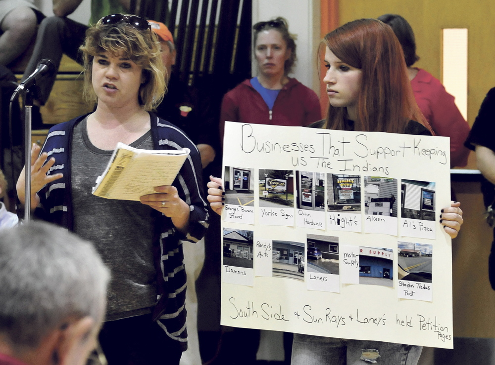 "Nicole Carter, left, speaks in support of the continued use of ""Indians"" for SAD 54 sports teams as Bailey Keister holds a sign of support during a forum in Skowhegan on Monday."