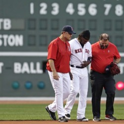 Red Sox left fielder Hanley Ramirez is helped from the field by manager John Farrell, left, and trainer Rick Jameyson during the first inning Monday night at Fenway Park. Ramirez left the game after running into a side wall while attempting a catch.